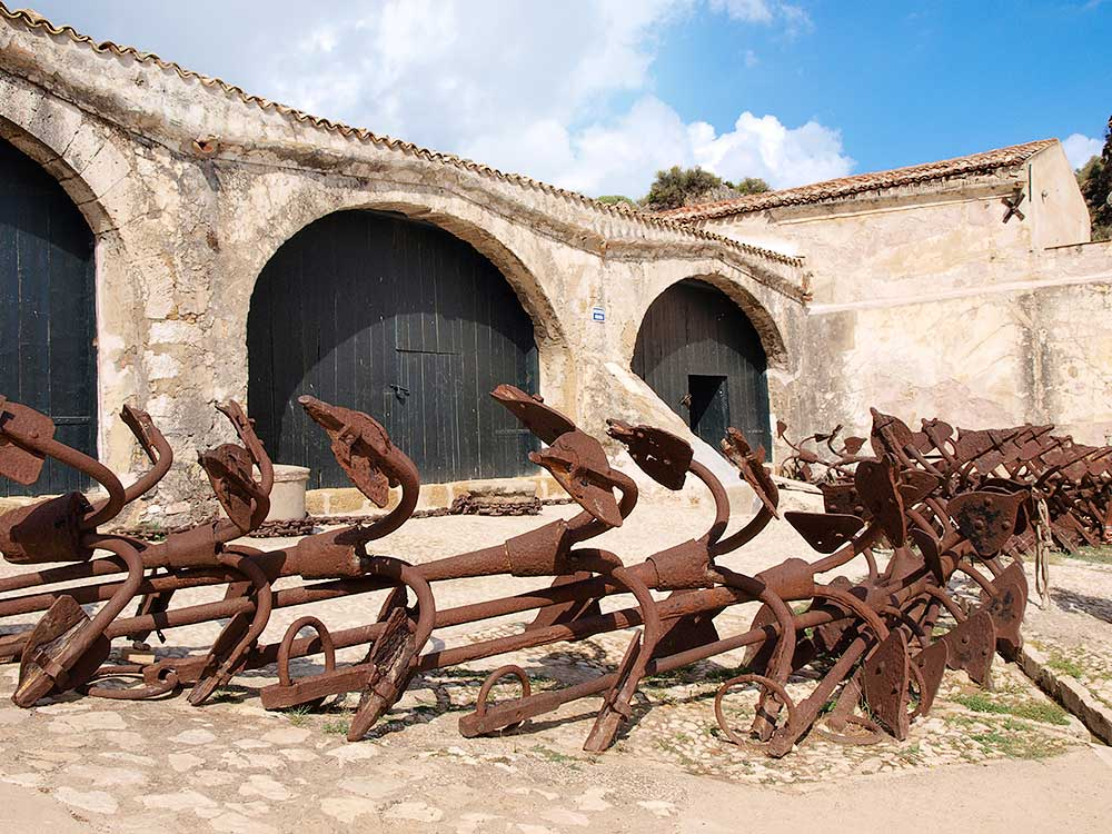 A collection of old anchors at the Scopello tonnara
