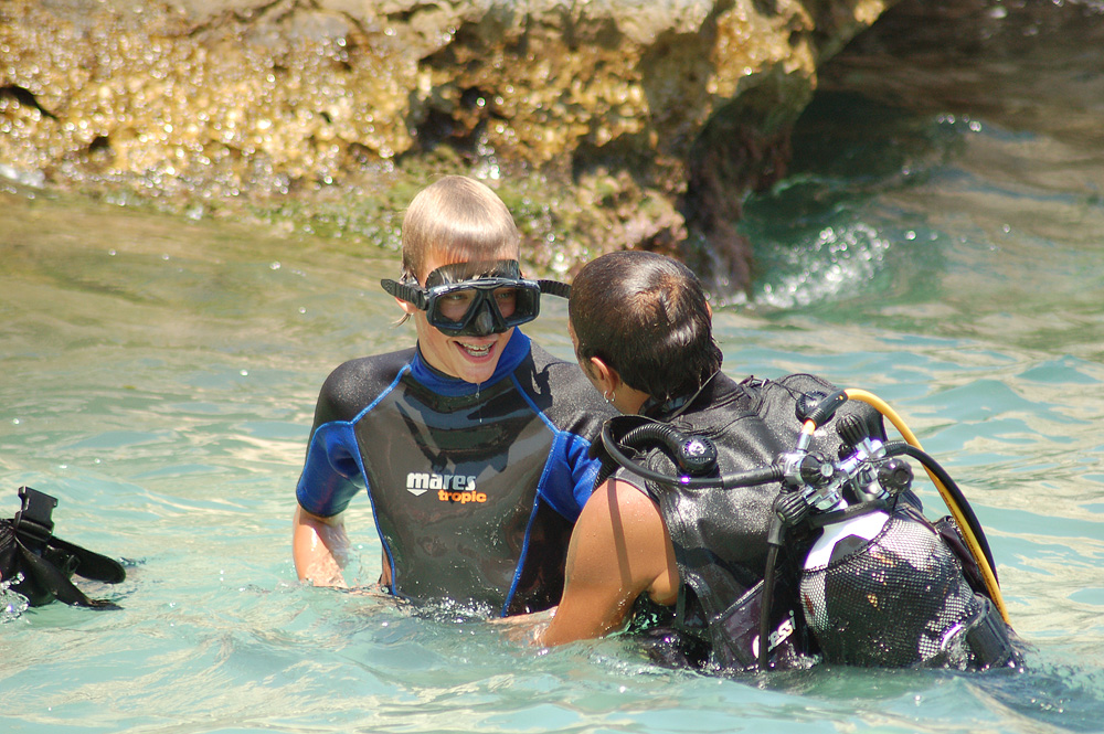 One of our guests receives a sea baptism (first dive) near the tonnara.