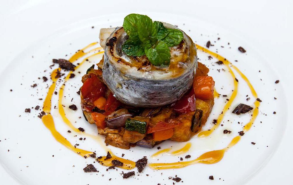 Typical Sicilian caponata with fresh fish