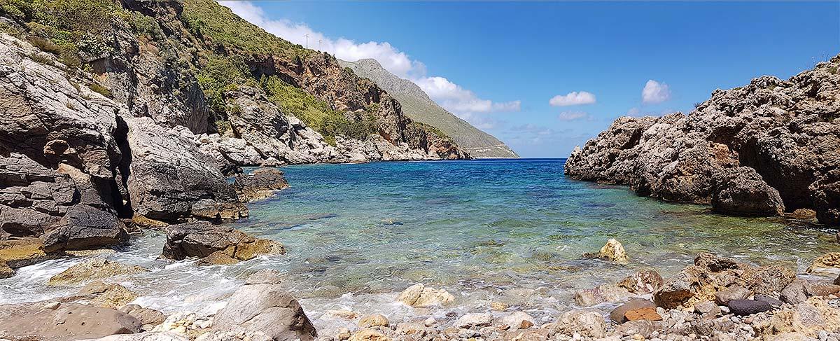 On the pebble beach of Cala Berretta